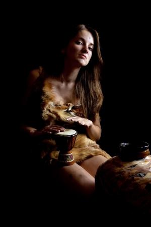 female shaman: Female shaman in foxcase with  tambourine at dark
