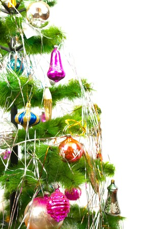 Part of Christmas fir tree with different balls on white background photo