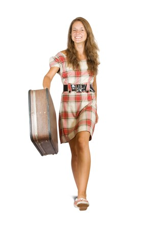 Girl  going with suitcase. Isolated over white background photo