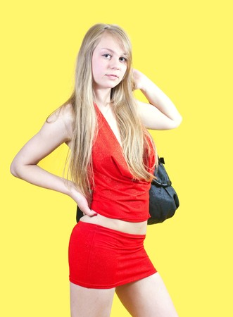 Sexy girl in red dress with purse