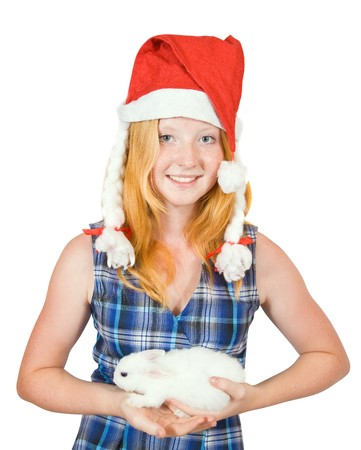 Teen girl  in santa hat with rabbit, isolated on white background Stock Photo - 7557447