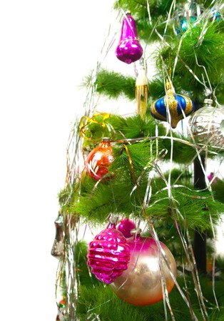 Closeup of Christmas fir tree with festive balls on white background photo