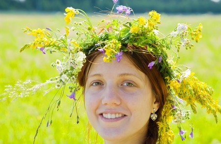 ordinary woman: Portrait of  girl in flowers  chaplet  against nature