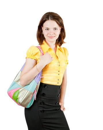 Attractive young girl with purse standing on white background
