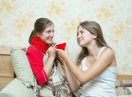 stupes: girl gives a cup to unwell girl