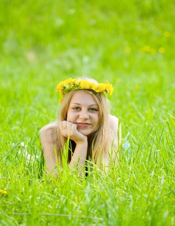 teeny: Blonde girl in  dandelion wreath at meadow Stock Photo