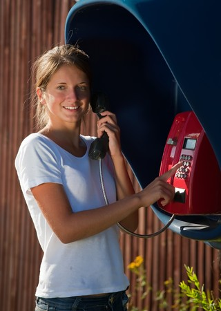 Young teenage girl in telephone box outdoor Stock Photo - 7661849