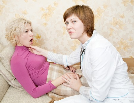 Female doctor loking to suffering girl on bed Stock Photo - 7661804