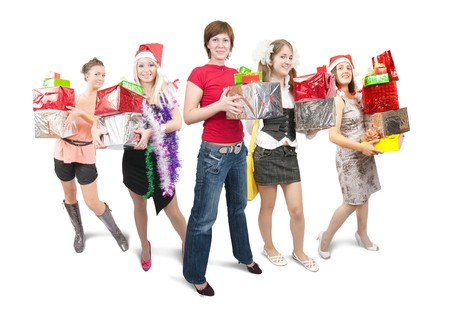 Group of nice girls holding coloured christmas gifts over white photo