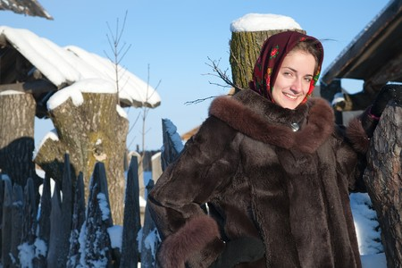teener: girl in russian traditional clothes against  winter landscape