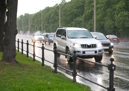 Cars on highway on a rainy evening Stock Photo