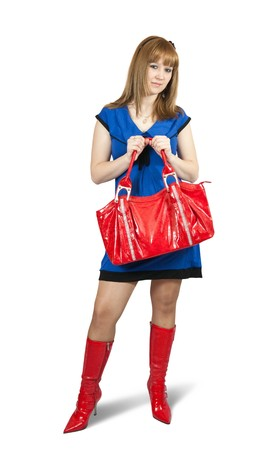 Girl in blue dress ang red high boots with purse. Isolated over white with clipping path Banco de Imagens