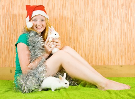 tawdry: teen girl in peddlery  with two pet rabbits  Stock Photo
