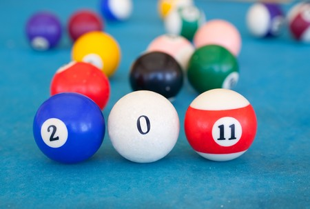billiard-ball are shown numerals in creative greeting card 2011 with New Year Stock Photo - 7704926
