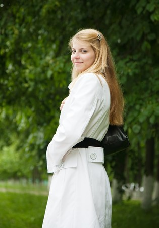 seasonable:  Pretty blonde girl in white cloak standing outdoors Stock Photo
