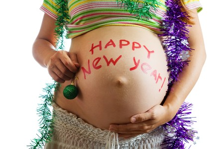 Closeup of Pregnant woman belly with HAPPY NEW YEAR!