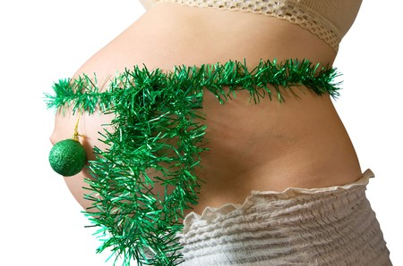tawdry: Closeup of Pregnant woman belly with christmas decorations