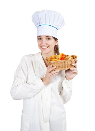 Attractive cook woman in toque with pastry over white background photo