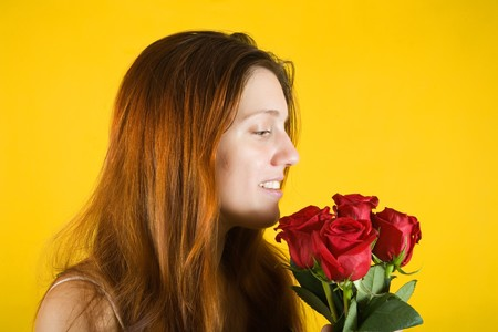 glamour portrait of pretty girl with rose flowers over yellow background photo