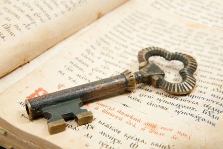 antique key: Closeup of key placed on an 18st century vintage book