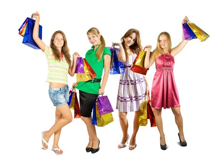 Group of girls holding shopping bags. Isolated in full length on white background photo