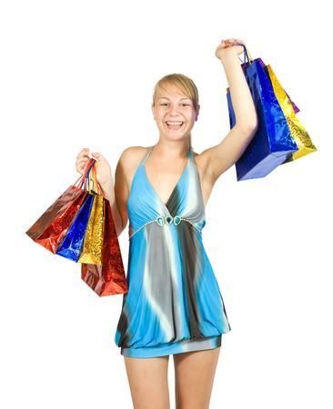 Happy girl holding shopping bags. Isolated over a white background photo