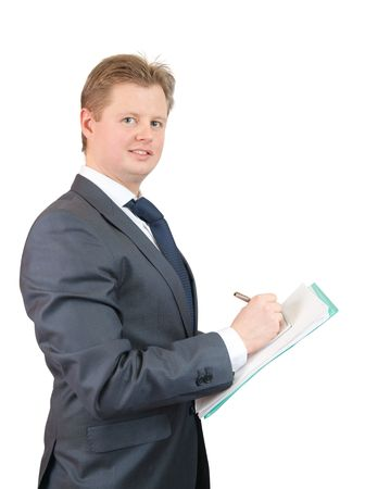 businessman  writing something on a notebook, isolated against a white background.  photo