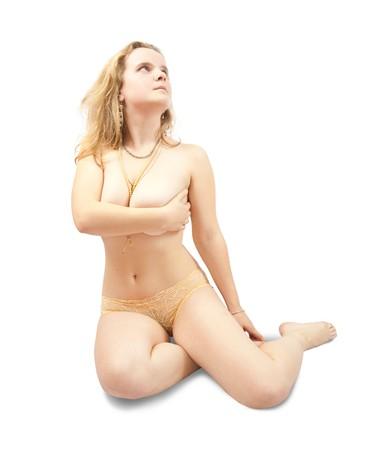 Sitting tender blonde girl in  beige shorts Stock Photo - 7777521