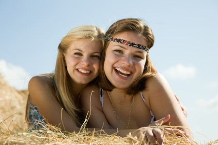 Portrait of country girls on hay in summer Stock Photo - 7777642