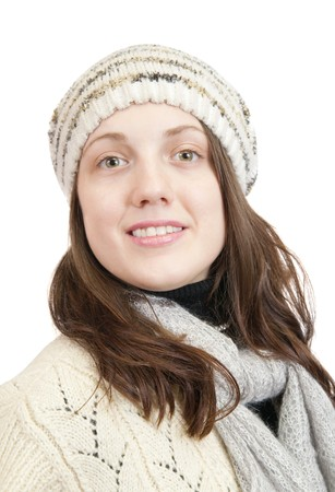 Portrait of Long-haired girl in sweater and cap over white photo