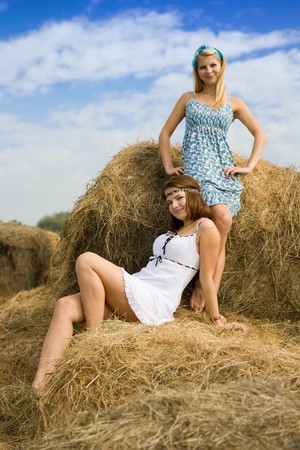 Portrait of country girls on hay in summer Stock Photo - 7873418