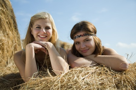 Happy girls on fresh hay at field Stock Photo - 7873416