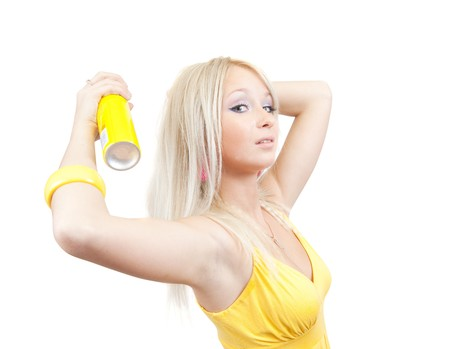 Blonde girl spraying hair lacquer onto her hair photo