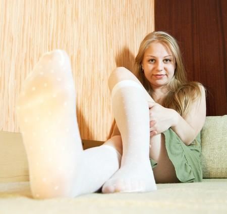 Sexy girl lying on sofa at home photo