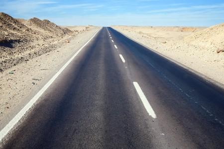 Road through desert landscape under cloudy sky Stock Photo - 7881615