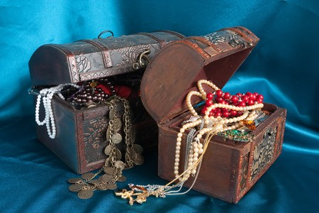 Two wooden treasure chests with valuables on blue textile Stock Photo - 7881616