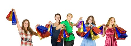 Group of   girls with shopping bags. Isolated over white background photo