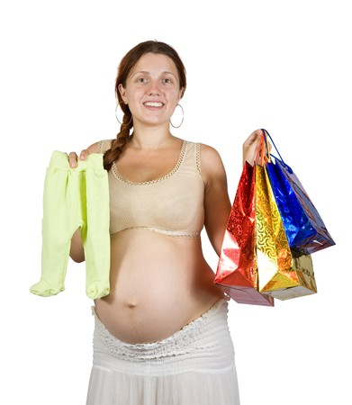 8 months pregnancy: pregnant woman with shopping bags and babys clothes.