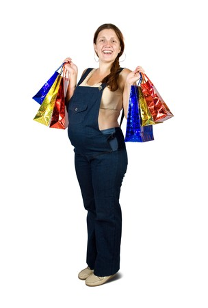 pregnant woman holding shopping bags. Isolated in full length on white background. photo