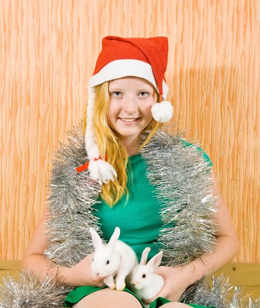 frippery: teen girl in peddlery  with two pet rabbits  Stock Photo