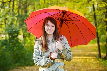 girl in cloak with umbrella in autumn park Stock Photo - 7941507