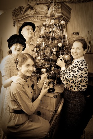Retro  photo of Family decorating Christmas tree at home Stock Photo - 7941552