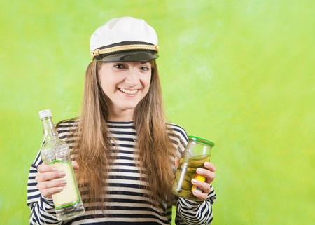 jack tar: Pretty female cabin boy with bottle of vodka Stock Photo