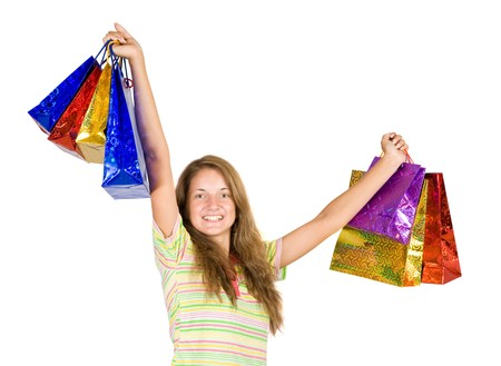 lovely girl with shopping bags over white photo