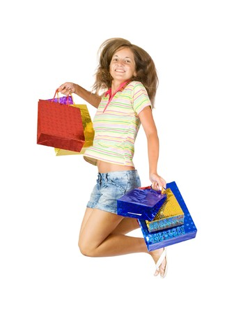 Happy teen girl with shopping bags. Isolated over a white background photo