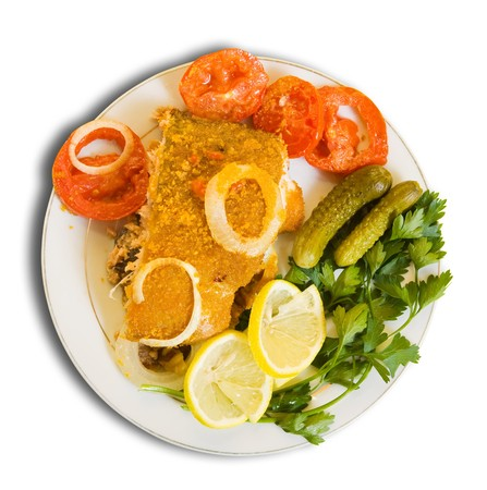 dog salmon:  breaded fish on plate  Isolated over white