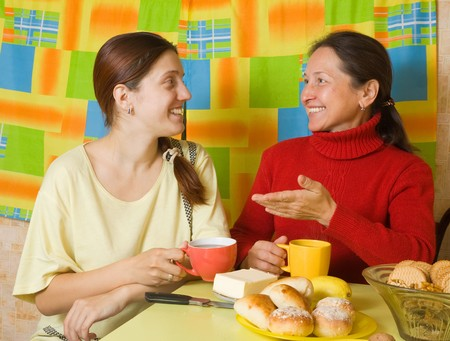 Girl and women drinking tea in the  kitchen Stock Photo - 7966142