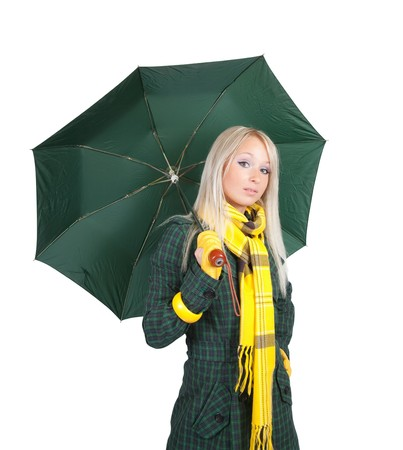 seasonable: Blonde girl  in green coat  with umbrella over white  Stock Photo