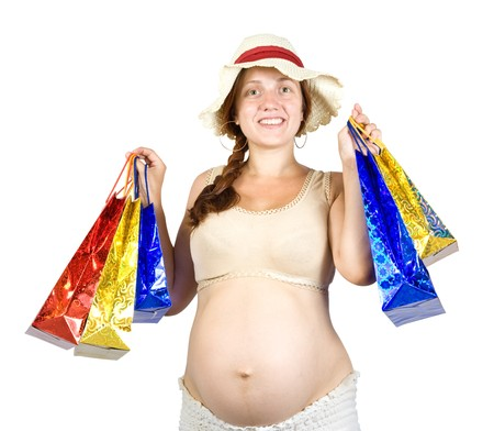 pregnant woman with shopping bags over white photo