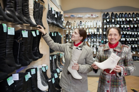 Two women shopping at fashion shoe store photo